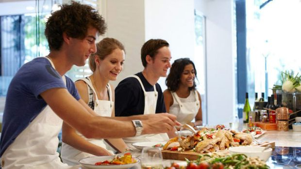 Students taste test the food at the Spring Brisbane cooking school.