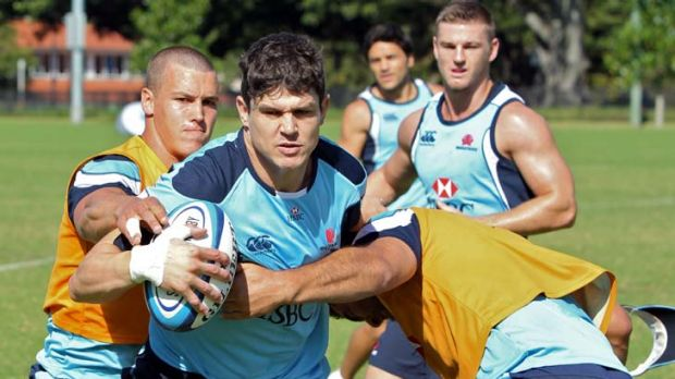 Statistical errors … Tom Carter hits the ball up at Waratahs training yesterday and will again pair with Rob ...