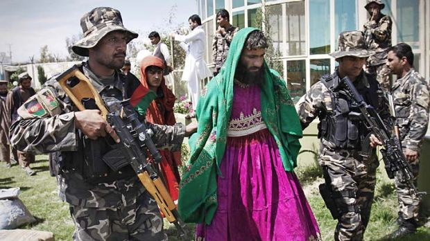 Taliban militants disguised as women are paraded in Laghman province. Shootings by militants of coalition forces have ...