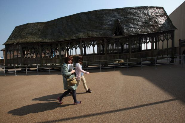 Visitors walk around a part of the set used for shots on the wooden bridge at Hogwarts. March 23, 2012.