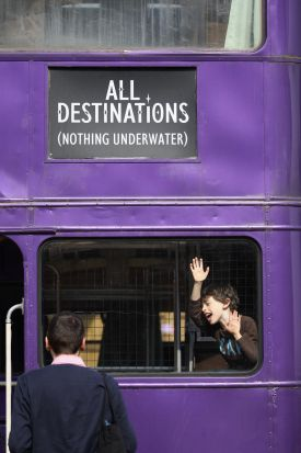 A boy plays on the 'Knight Bus', a purple triple decker bus used in the 'Harry Potter and the Prisoner of Azkaban'. ...