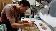 Frankincense infused hot cross buns being made by head chef Buster Brown at 'Black Star Pastry' in Newtown, Sydney. 30th ...