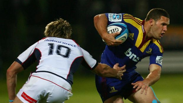 Shaun Treeby of the Highlanders makes a break past James O'Connor.
