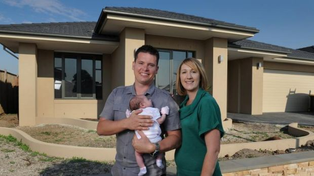 John and Erin Wilkinson, with daughter Liliana, 6 weeks, are among the new home buyers flocking to Point Cook, in the ...