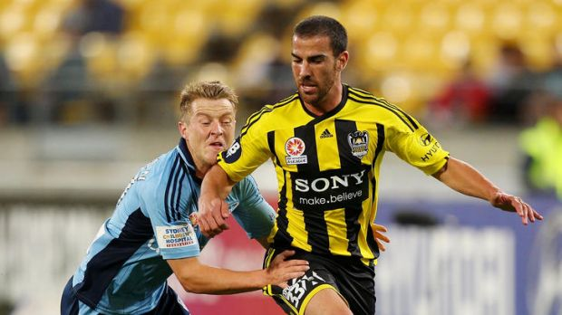 Scott Jamieson of Sydney FC tackles Manny Muscat of the Phoenix.