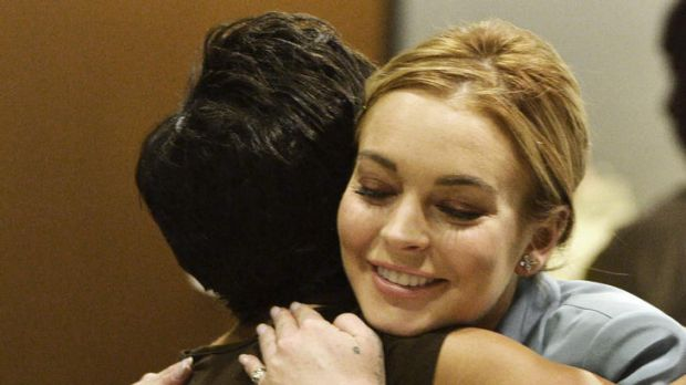 Lindsay Lohan hugs her attorney Shawn Holley after the hearing.