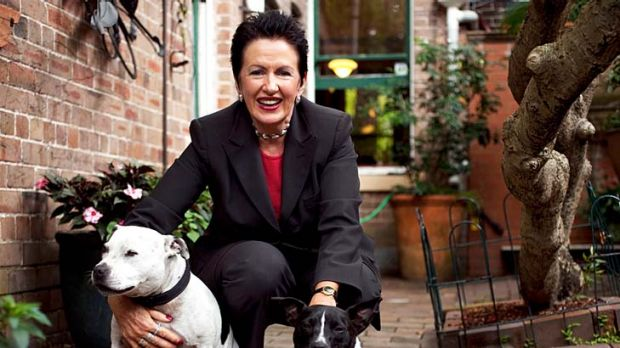 Clover Moore ... in the backyard with her beloved dogs Banjo and Bessie.