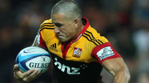 Sonny Bill Williams of the Chiefs is tackled by Berrick Barnes of the Waratahs.