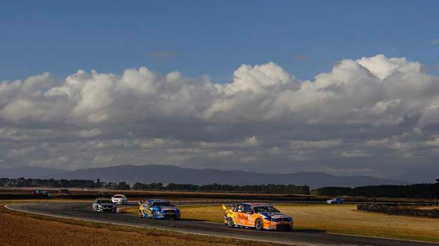 Driving to the top: Will Davison leads teammate Mark Winterbottom to victory in Tasmania yesterday to continue the Ford ...