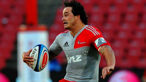 Zac Guildford of the Crusaders avoids a tackle.