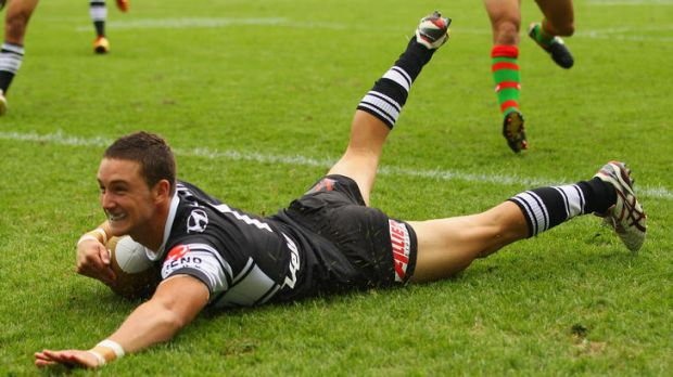 Tim Moltzen of the Tigers scores an early try against South Sydney Rabbitohs