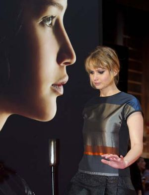 <i>The Hunger Games</i> star Jennifer Lawrence attends an event with fans in Madrid last week.