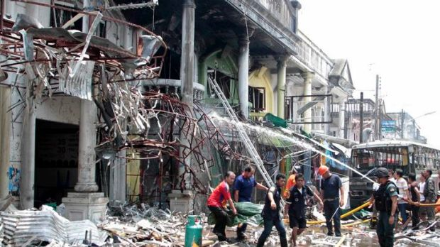 Rescue workers remove a body after a bomb blast in southern Thailand's Yala province on Saturday.