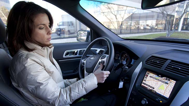 Rebecca Paquette of Nuance Communications' mobile division gives instructions to its voice-activated system in a Ford ...