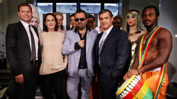 All dressed up: Napoleon Perdis (centre in sunnies) with DJ's chief executive Paul Zahra to his left.