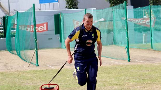 Peter Siddle warms up in Barbados yesterday.