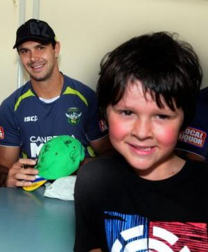 Prop Dane Tilse signs an autograph at a Raiders fan day yesterday. He will come into the Green Machine's 17 at the ...
