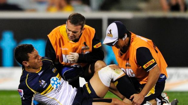 Matt Toomua in distress after rupturing his ACL against the Sharks on Saturday night.