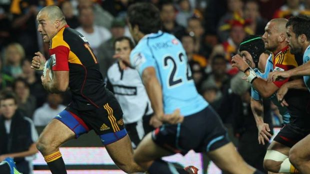 On the run … Chiefs centre Richard Kahui storms through the Waratahs defence during the home side's 30-13 victory ...