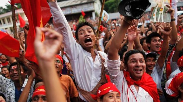 Supporters celebrate as results are announced at Aung San Suu Kyi's National League for Democracy head office in Yangon.