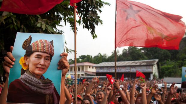 National League for Democracy (NLD) supporters hold up a picture of Aung San Suu Kyi while celebrating their victory in ...