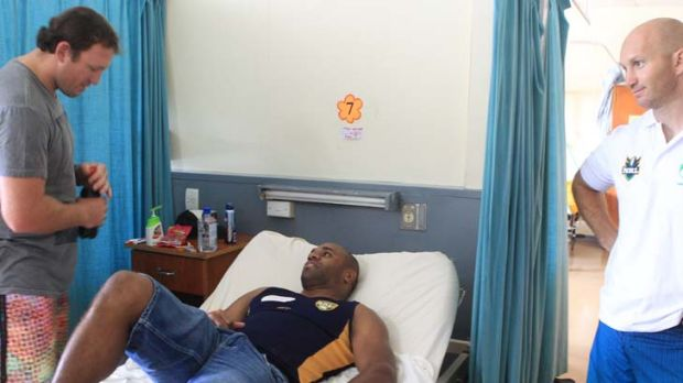 Visitors welcome ... Matt Cross and Adam MacDougall visit Rhys Wesser in his hospital room in Nadi after the former ...