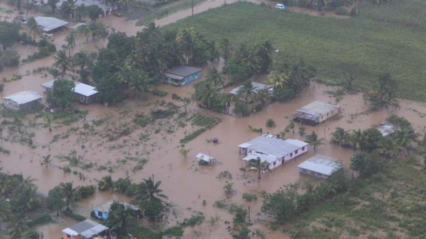 Impacted ... Matt Cross, Adam MacDougall and Rhys Wesser became caught up in the floods which ravaged the Island.