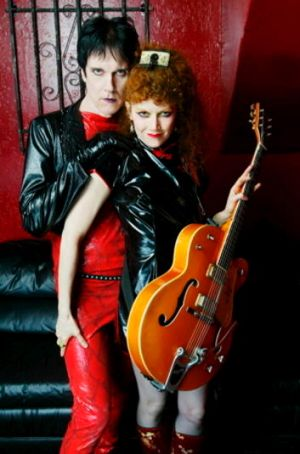 Lux Interior and Poison Ivy of the Cramps.