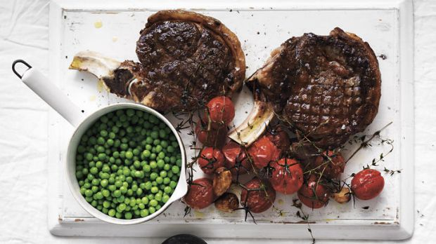Grilled beef rib-eye with peas and roasted cherry tomatoes.