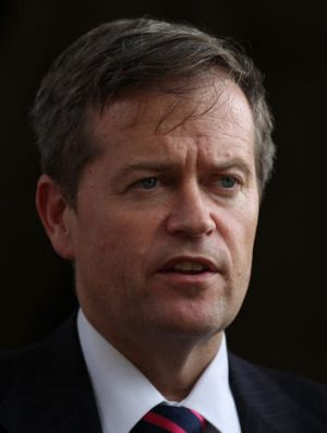 Bill Shorten said employees were spending up to a third of their time on 'inefficient time-wasting tasks'.