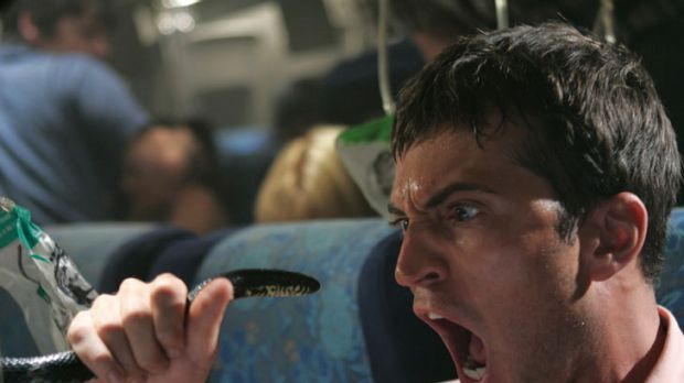 Life imitates art: A scene from much-derided film <i>Snakes on a Plane</i>.