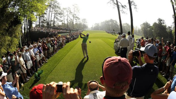Centre stage: Tiger Woods tees off during a practice at Augusta on Wednesday, still chasing Jack Nicklaus' record of 18 ...