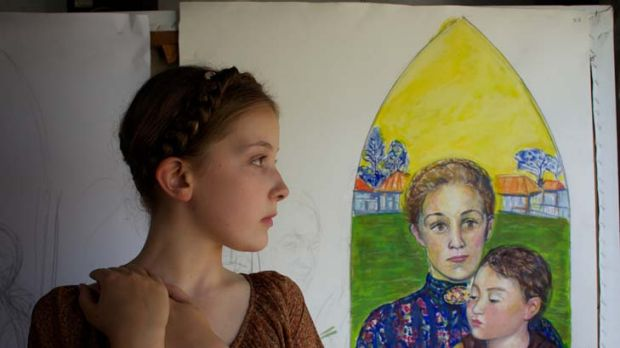 Purity of spirit ... Lauren Lancaster, 10, stood in as Mary MacKillop for Salvatore Zofrea's design for a stained-glass ...