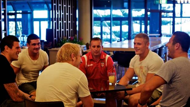Red alert … England coach Steve McNamara (red shirt) catches up with English NRL imports, clockwise from left, ...