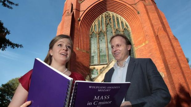 Soprano Siobhan Stagg and conductor Peter Tregear outside the Trinity College chapel at Melbourne University.