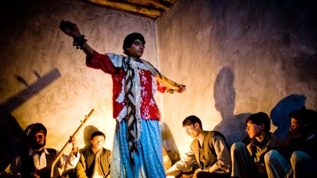 Entertainment to exploitation ... an Afghan bacha bazi performs for an audience of men.