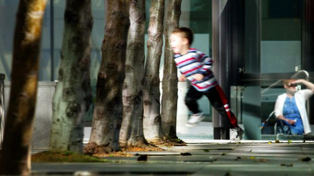 A child plays outside the Family Court, which will still hear the bulk of cases involving a parent's proposed move overseas.