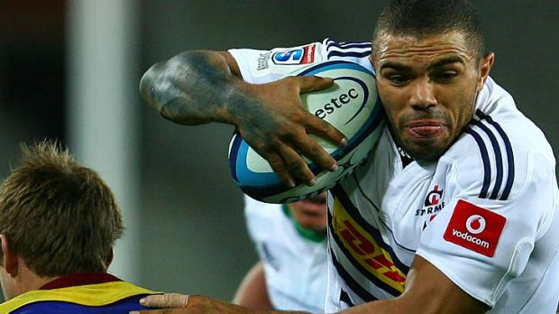 Bryan Habana of the Stormers attempts to blast past Chris Noakes of the Highlanders.