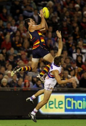 As the Crow flies: Forward Taylor Walker marks spectacularly over Bulldog Ryan Hargrave.