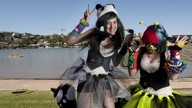 Fifteen-year-olds Bethany Hunter and Jemma Ludke enjoyed the Queensland sunshine at a rave event at New Farm Park on ...