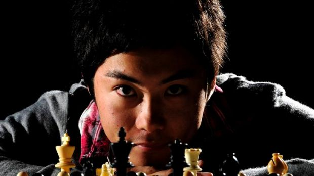 Canberra's Junta Ikeda takes part in the 50th Doeberl Cup chess tournament held at the Hellenic Club, Woden.