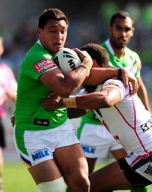 Canberra's Josh Papalii is tackled by New Zealand's Manu Vatuvei.