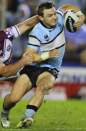 Down but not out ... Nathan Gardner tore his anterior cruciate ligament in the Sharks 12-0 defeat of the Dragons.