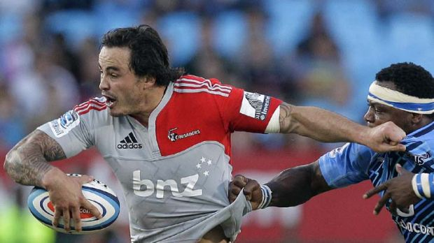 Snagged … Zac Guildford of the Crusaders tries to break through the Bulls' defence in Pretoria during his team's ...