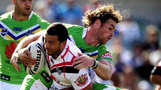 Hold on ... Canberra's Joe Picker grabs Warrior Ben Matulino.