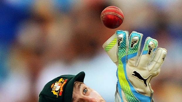 Wicketkeeper Matthew Wade fields a ball during the first day.