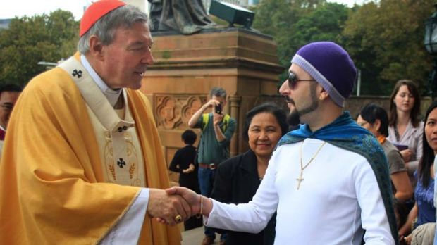 Meet the congregation ... Cardinal George Pell greets Con Ditsas outside St Mary's Cathedral after Easter Sunday morning ...