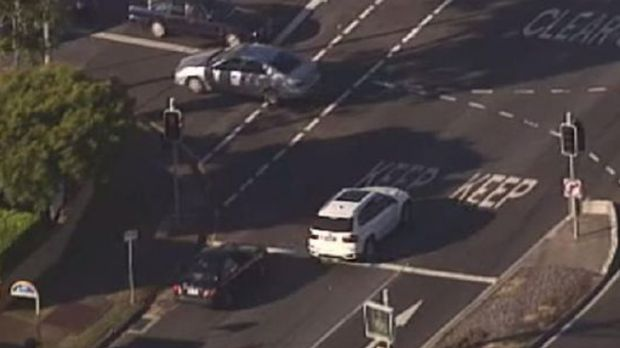Police pursue the driver of a white vehicle in Brisbane's south on Monday. Photo: Channel 9.