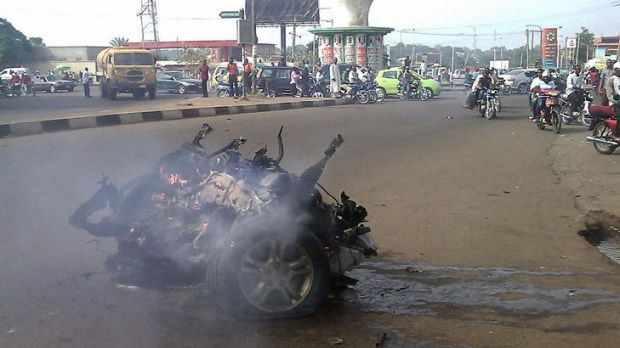 Debris of a car at the site of an explosion in Kaduna.
