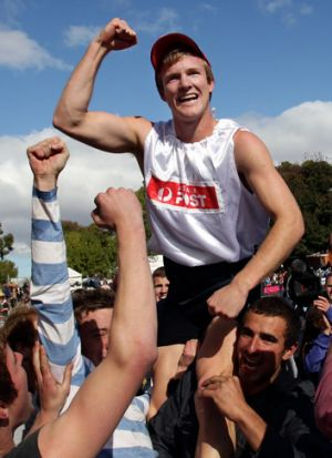 Cut above the rest: Matt Wiltshire celebrates after his Stawell Gift win.